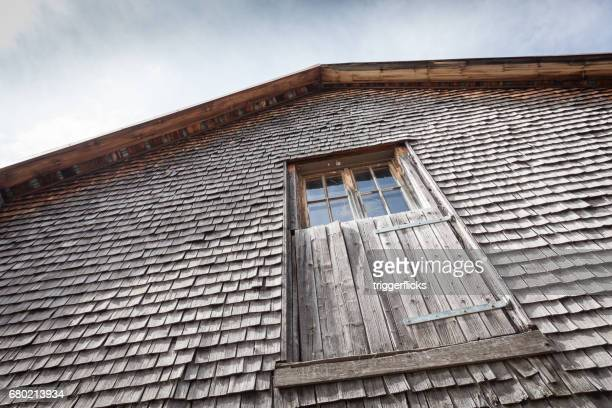 Wall with shingles of a vintage farm house