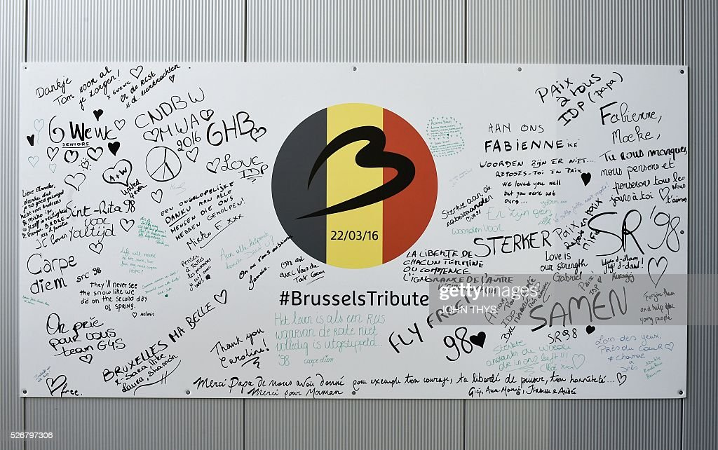 A wall with signatures of airport workers is pictured during the partial reopening of the departure hall of Brussels Airport in Zaventem on May 1, 2016, after it was badly damaged in twin suicide attacks on March 22, that killed 16 people. A total of 32 people were killed and more than 300 wounded in coordinated suicide bombings at the airport and a metro station in central Brussels on March 22 in Belgium's worst ever terror attacks. / AFP / JOHN