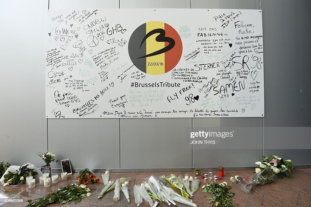 A wall with signatures of airport workers is pictured on May 1, 2016 during the partial reopening of the departure hall of Brussels Airport in Zaventem, after it was badly damaged in twin suicide attacks on March 22, that killed 16 people. A total of 32 people were killed and more than 300 wounded in coordinated suicide bombings at the airport and a metro station in central Brussels on March 22 in Belgium's worst ever terror attacks. / AFP / JOHN