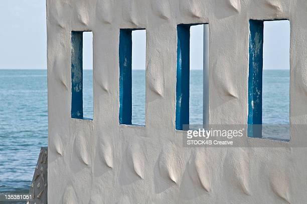 Wall with windows at the ocean, Sichon, Thailand
