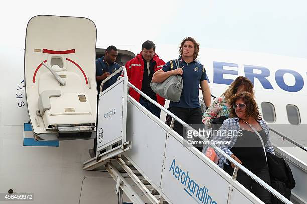 Wallabies captain Michael Hooper and team mates arrive at Mendoza Airport on October 1 2014 in Mendoza Argentina Australia are playing a Rugby...