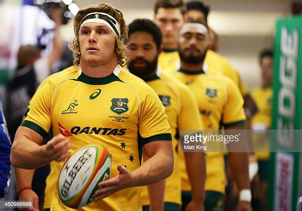 Wallabies captain Michael Hooper leads his team out onto the field during the International Test match between the Australian Wallabies and France at...