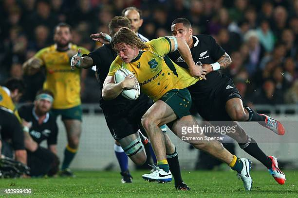 Wallabies captain Michael Hooper makes a break during The Rugby Championship match between the New Zealand All Blacks and the Australian Wallabies at...