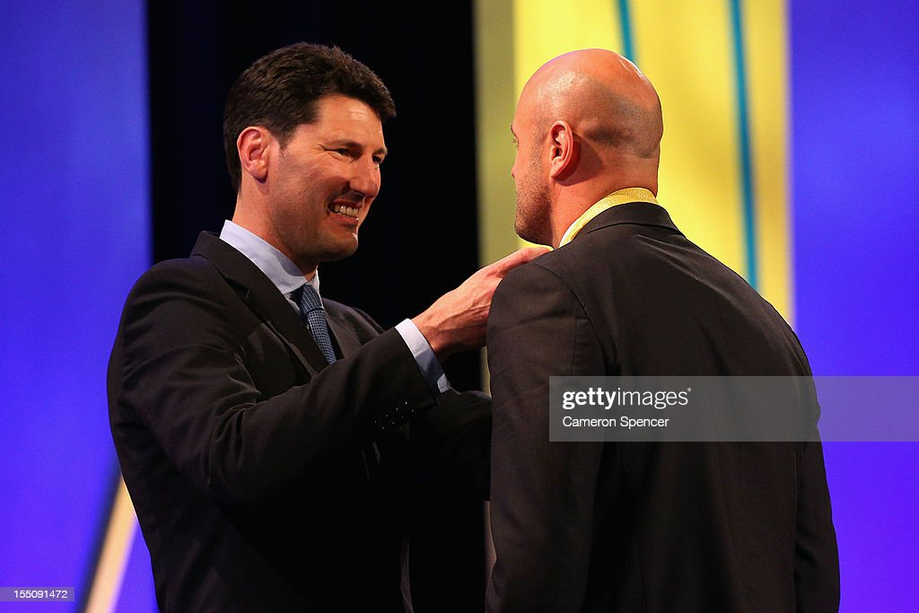 Wallabies captain Nathan Sharpe accepts the award 'The John Eales Medal' from former Wallabies captain John Eales during the John Eales Medal at the Sydney Convention and Exhibition Centre on November 1, 2012 in Sydney, Australia.