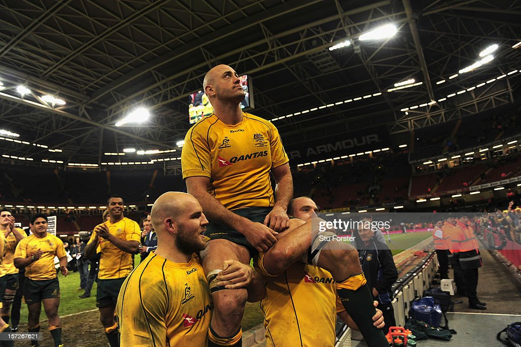 Wallabies captain <a gi-track='captionPersonalityLinkClicked' href=/galleries/search?phrase=Nathan+Sharpe&family=editorial&specificpeople=208152 ng-click='$event.stopPropagation()'>Nathan Sharpe</a> is chaired off after his last test match after the International match between Australia and Wales at Millennium Stadium on December 1, 2012 in Cardiff, Wales.