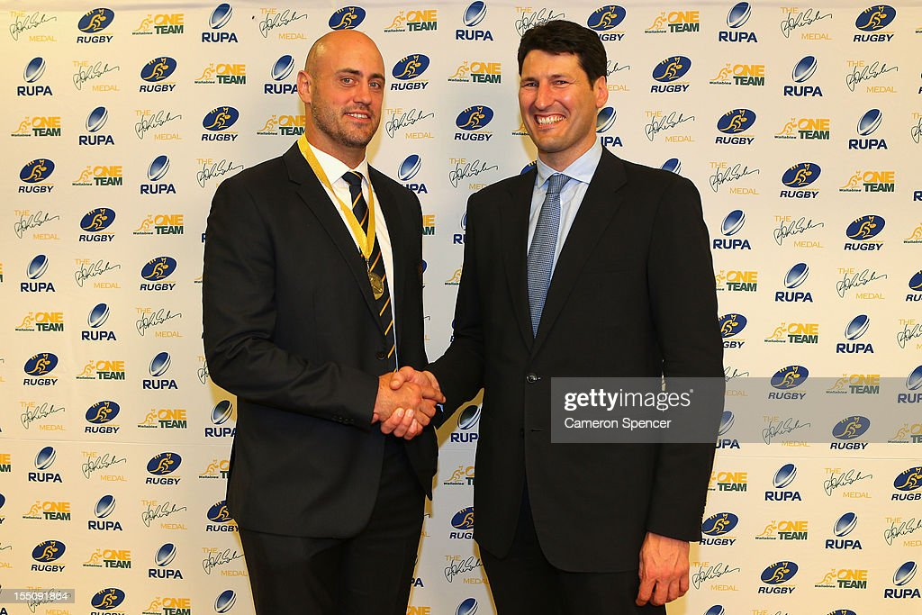 Wallabies captain Nathan Sharpe poses with former Wallabies captain John Eales after accepting 'The John Eales Medal' during the John Eales Medal at the Sydney Convention and Exhibition Centre on November 1, 2012 in Sydney, Australia.