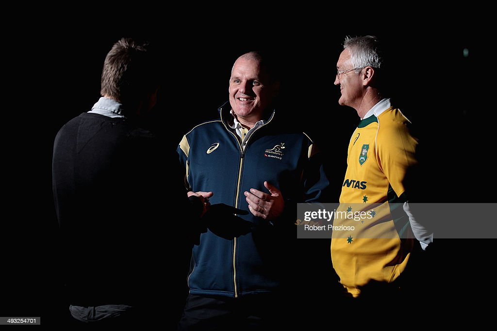 Wallabies coach Ewen McKenzie along with Minister Damian Drum speak to media during a media session at Etihad Stadium on May 23 2014 in Melbourne...