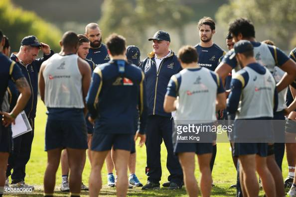 Wallabies coach Ewen McKenzie speaks to players during an Australian Wallabies training session at Sydney Grammer School fields on August 21 2014 in...
