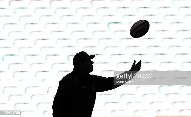 Wallabies coach Ewen McKenzie throws catches the ball during the Australian Wallabies Captain's Run at ANZ Stadium on August 16 2013 in Sydney...