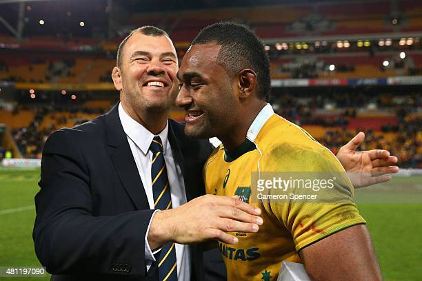Wallabies coach Michael Cheika celebrates with Tevita Kuridrani of the Wallabies after winning the Rugby Championship match between the Australian...