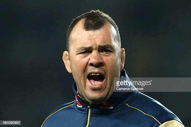 Wallabies coach Michael Cheika watches his team warm up during The Rugby Championship Bledisloe Cup match between the New Zealand All Blacks and the...