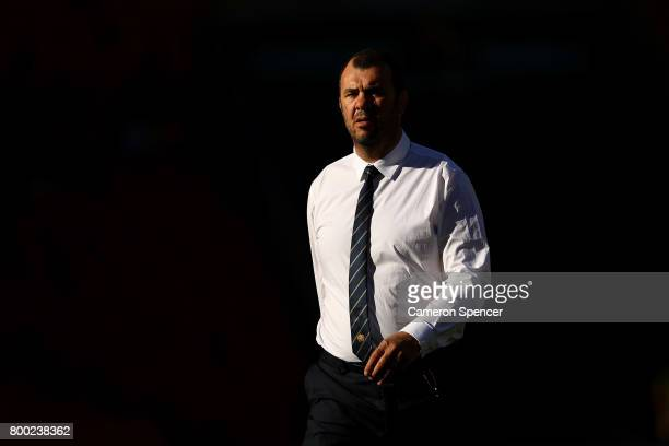 Wallabies coach Michael Cheika watches his team warm up during the International Test match between the Australian Wallabies and Italy at Suncorp...