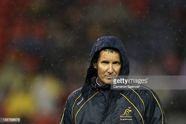 Wallabies coach Robbie Deans watches players warm up during the International Test match between the Australian Wallabies and Scotland at Hunter...
