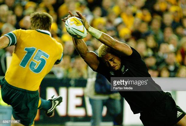 Wallabies Drew Mitchell has a kick charged down by New Zealand's Jerry Collins in the Bledisloe Cup at Telstra Stadium 13 August 2005 AFR Picture by...