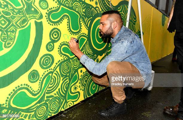 Wallabies Indigenous jersey artist Denis Goulding signs his art work during an ARU media opportunity on October 16 2017 in Brisbane Australia