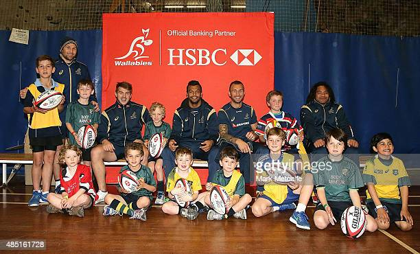 Wallabies players Matt Giteau Drew Mitchell Kurtley Beale Quade Cooper and Tatafu PolataNau pose with kids during HSBC Rugby Festival at Sydney...