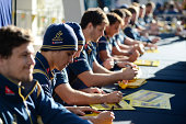 Wallabies players sign autographs for fans during an Australian Wallabies fan day event at The Mondo on August 8 2014 in Penrith Australia