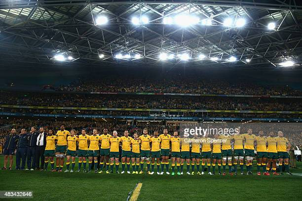 Wallabies players sing the Australian national anthem during The Rugby Championship match between the Australia Wallabies and the New Zealand All...