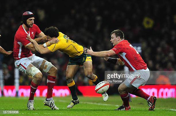 Wallabies scrum half Nick Phipps is stopped by Luke Charteris and Matthew Rees during the International match between Australia and Wales at...