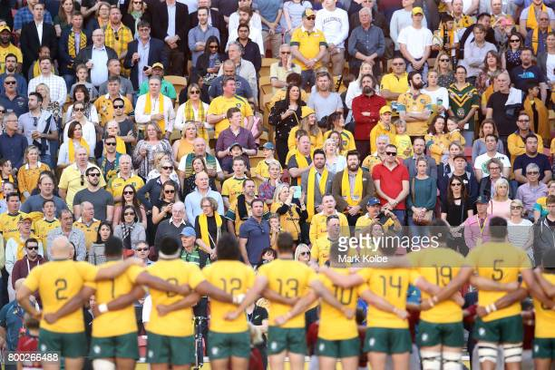 Wallabies supporters in the crowd sing the anthem before the International Test match between the Australian Wallabies and Italy at Suncorp Stadium...