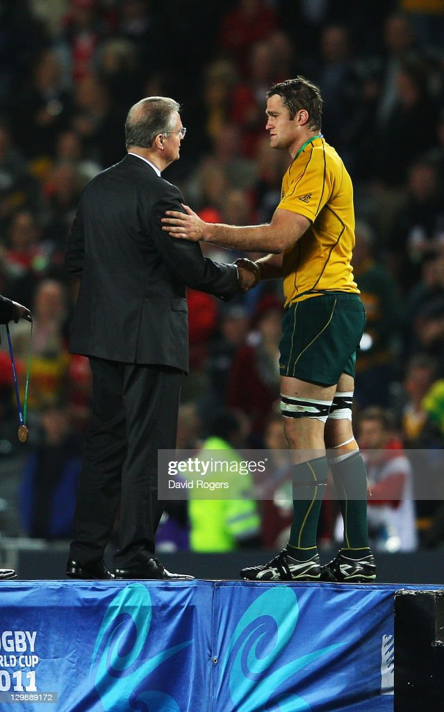 Wallaby captain <a gi-track='captionPersonalityLinkClicked' href=/galleries/search?phrase=James+Horwill&family=editorial&specificpeople=637477 ng-click='$event.stopPropagation()'>James Horwill</a> receives his bronze medal from IRB Chairman <a gi-track='captionPersonalityLinkClicked' href=/galleries/search?phrase=Bernard+Lapasset&family=editorial&specificpeople=769984 ng-click='$event.stopPropagation()'>Bernard Lapasset</a> during the 2011 IRB Rugby World Cup bronze final match between Wales and Australia at Eden Park on October 21, 2011 in Auckland, New Zealand.