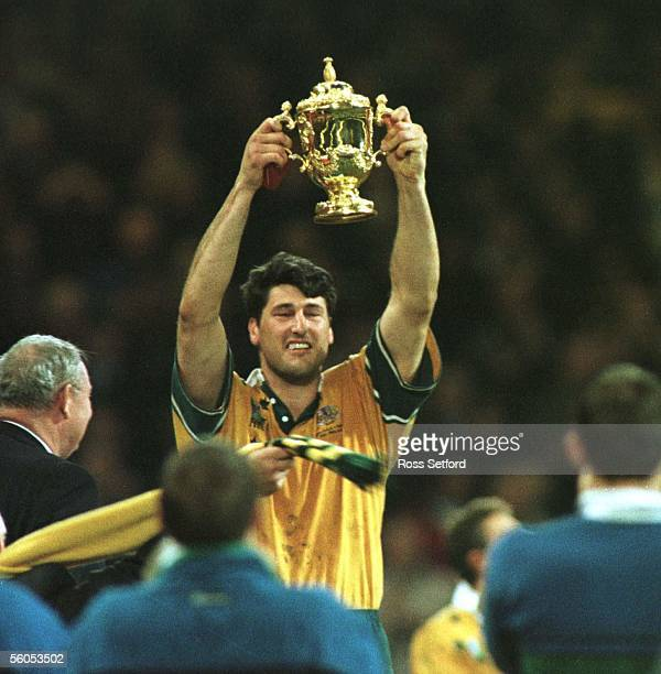Wallaby captain John Eales holds aloft the Rugby World Cup after they defeated France in the final 3512 at the Millennium Stadium Cardiff Saturday