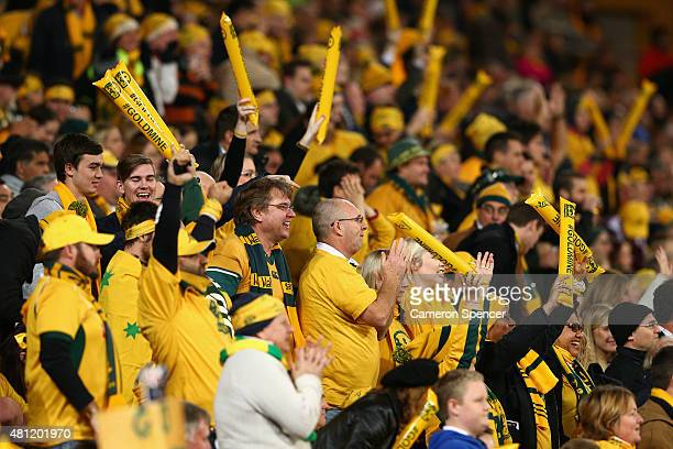 Wallaby fans celebrate a try during The Rugby Championship match between the Australian Wallabies and the South Africa Springboks at Suncorp Stadium...