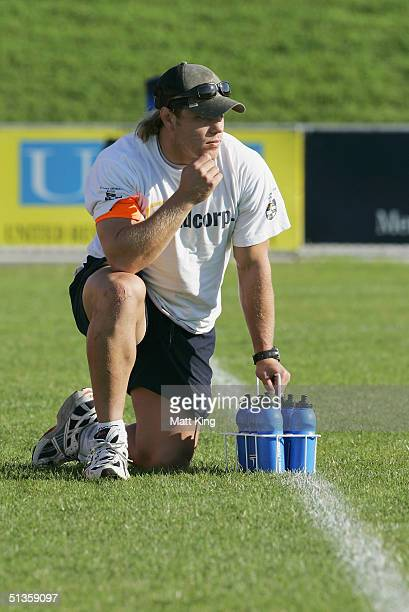 Wallaby player Phil Waugh acts as a trainer for his club Sydney Uni during the Tooheys New Cup minor semi final between Sydney Uni and Manly held at...
