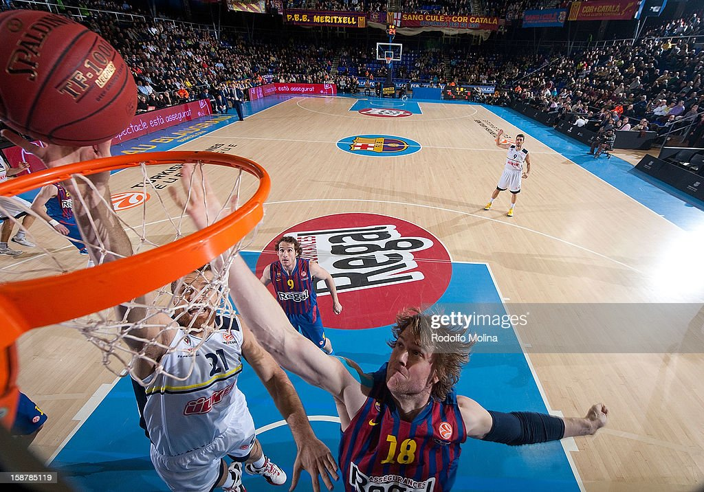 C.J. Wallace, #18 of FC Barcelona Regal competes with Oguz Savas, #21 of Fenerbahce Ulker Istanbul during the 2012-2013 Turkish Airlines Euroleague Top 16 Date 1 between FC Barcelona Regal v Fenerbahce Ulker Istanbul at Palau Blaugrana on December 28, 2012 in Barcelona, Spain.