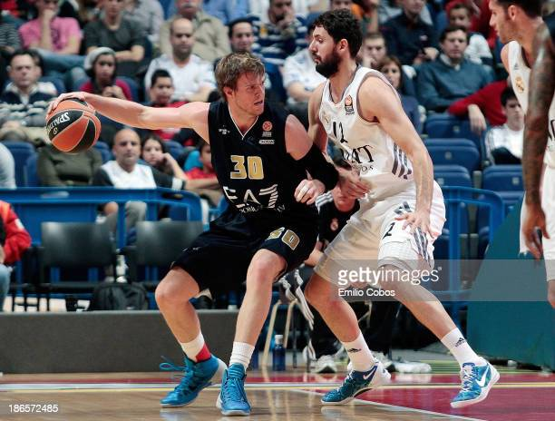 J Wallace #30 of EA7 Emporio Armani Milan competes with Nikola Mirotic #12 of Real Madrid during the 20132014 Turkish Airlines Euroleague Regular...