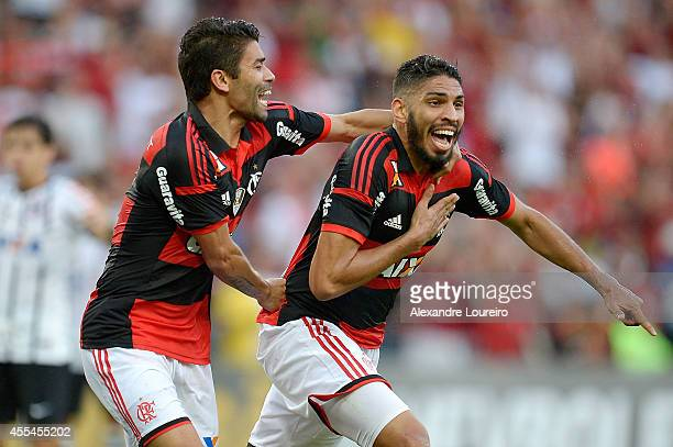 Wallace and Eduardo da Silva of Flamengo celebrates a scored goal by Wallace during the match between Flamengo and Corinthians as part of Brasileirao...
