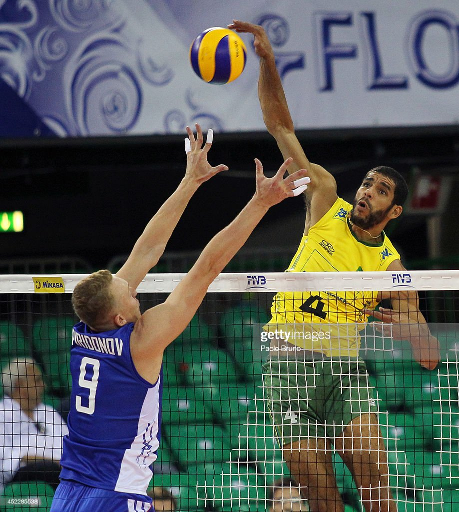 Wallace De Souza of Brazil spikes the ball as Alexey Spiridonov of Russia blocks during the FIVB World League Final Six match between Russia and Brazil at Mandela Forum on July 17, 2014 in Florence, Italy.