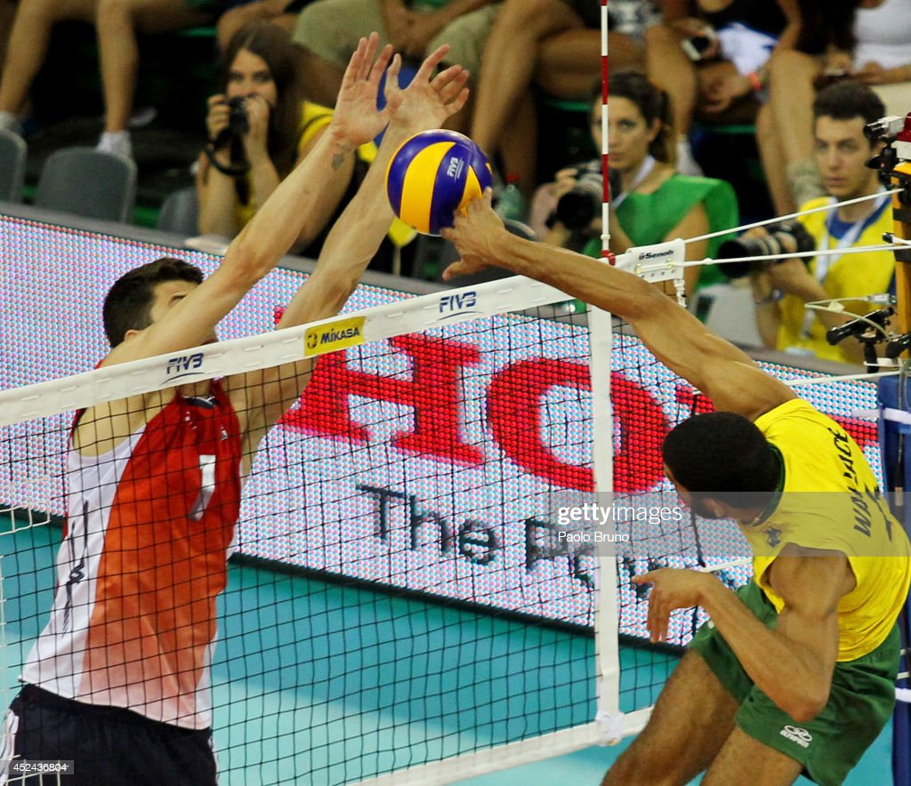Wallace De Souza of Brazil spikes the ball as Matthew Anderson of United States blocks during the FIVB World League Final Six match for the first place between United States and Brazil at Mandela Forum on July 20, 2014 in Florence, Italy.