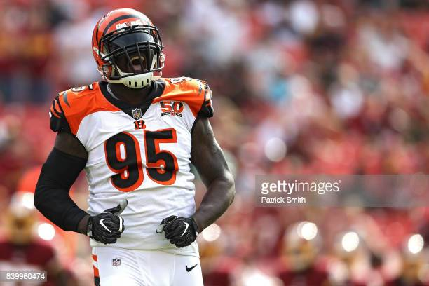 Wallace Gilberry of the Cincinnati Bengals reacts after sacking quarterback Kirk Cousins of the Washington Redskins in the first quarter during a...