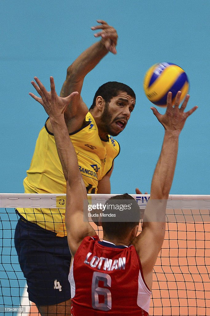 Wallace of Brazil in action against Lotman (#6) of USA during a match between Brazil and USA as part of the FIVB Volleyball World League 2013 at the Maracanazinho gymnasium on July 14, 2013 in Rio de Janeiro, Brazil.