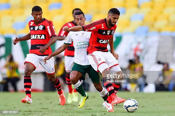 Wallace of Flamengo struggles for the ball with Juninho of Palmeiras during a match between Flamengo and Palmeiras as part of Brasileirao Series A...