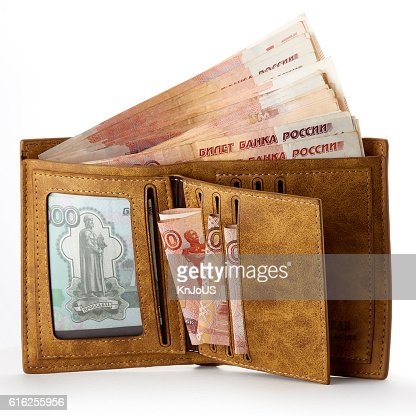 Wallet full of money. Big salary. Isolated object on white. : Foto de stock