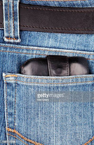 Wallet in a denim jeans pocket
