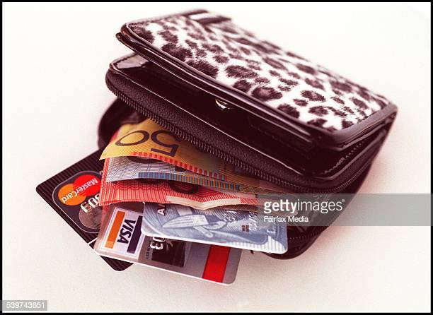 A wallet stuffed with cash and credit cards 29 December 1998 AFR Picture by LOUISE KENNERLEY