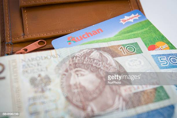 A wallet with a discount card from the French Auchan supermarket is seen