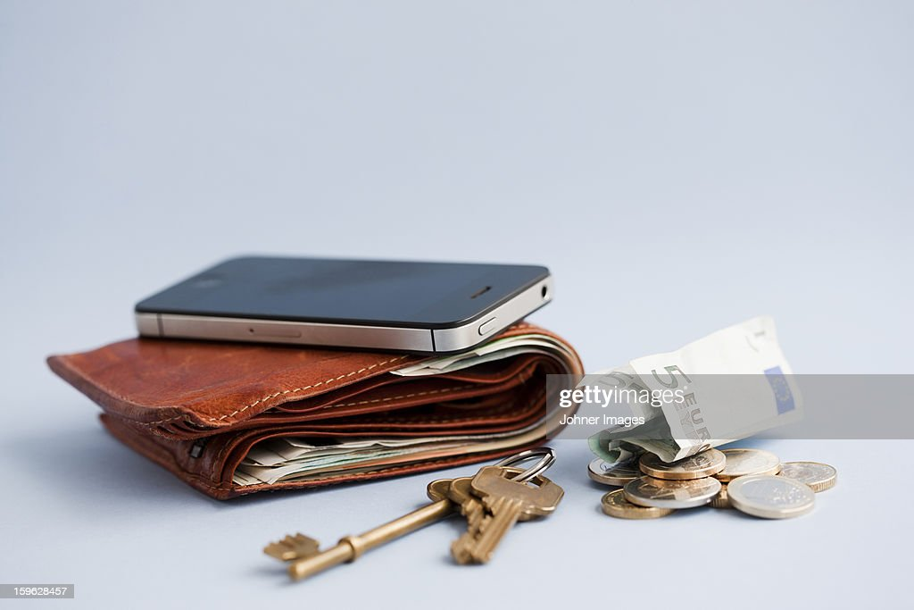 Wallet with cash, phone and keys : Stock Photo