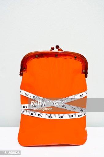 Carteira envolto em fita métrica Mostrar uma dieta Financeiro