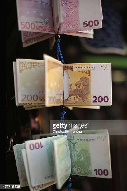Wallets depicting Euro notes are seen for sale outside a souvenir shop on July 7 2015 in Athens Greece Greek Prime Minister Alexis Tsipras is working...