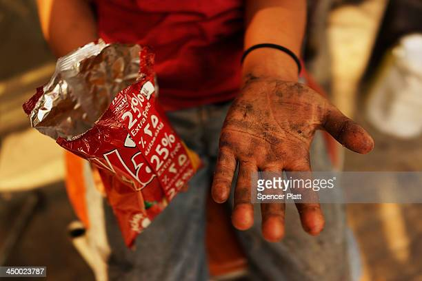 Wallid a Syrian refugee from the city of Daraa displays his hand while taking a break from shining shoes in a wealthy district of Beirut on November...