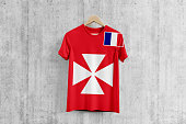 Wallis And Futuna flag T-shirt on hanger, team uniform design idea for garment production. National wear.