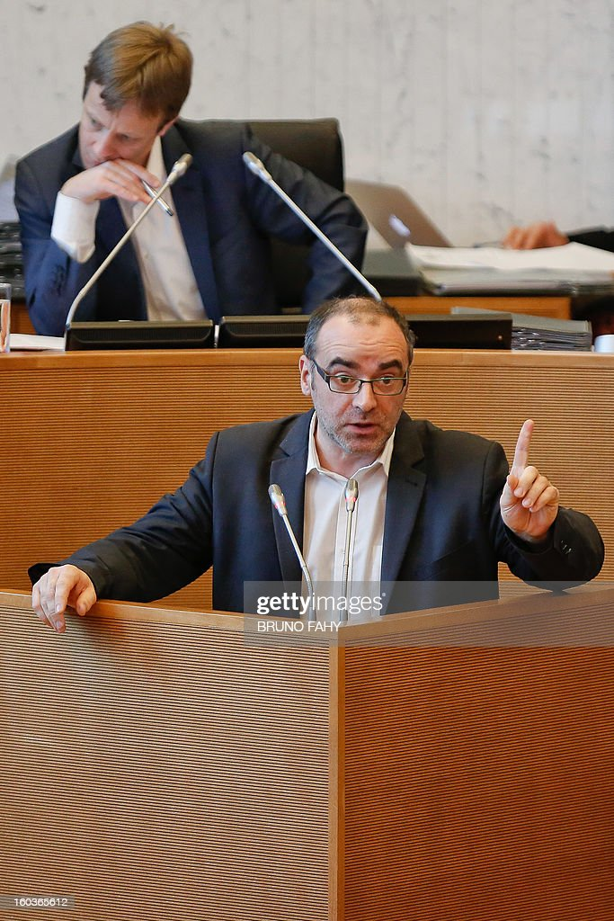 Wallon deputy Christian Noiret (DOWN) speaks during a plenary session of the Walloon parliament in Namur on January 30, 2013 focusing on the layoffs of some 1300 steel workers. Steel giant ArcelorMittal said it would close six cold-processing facilities in the Liege region of eastern Belgium, eliminating 1,300 jobs. In Belgium, in an echo of other once-powerhouse industries such as coal and shipbuilding, the numbers employed in the steel business collapsed from some 34,000 in 1981 to under 10,000 this year. AFP PHOTO / BELGA / BRUNO FAHY