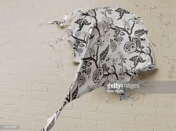 Wallpaper paint splattering on white background
