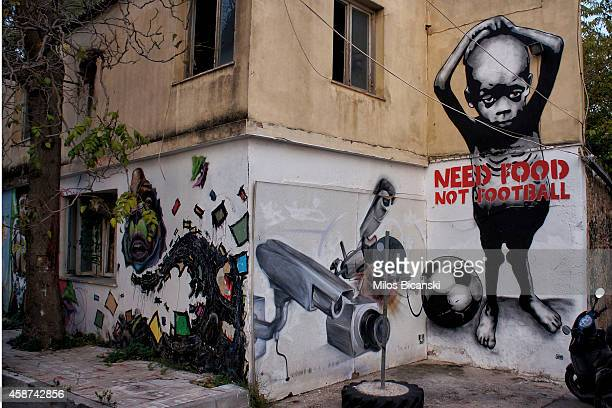 Walls are adorned with works of contemporary graffiti on the streets of Athens on November 6 2014 in Athens Greece The hardships and unemployment of...