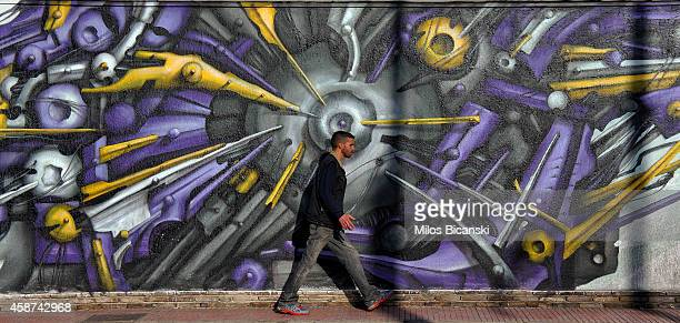 Walls are adorned with works of contemporary graffiti on the streets of Athens on November 10 2014 in Athens Greece The hardships and unemployment of...