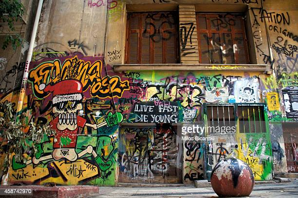 Walls are adorned with works of contemporary graffiti on the streets of Athens on November 7 2014 in Athens Greece The hardships and unemployment of...